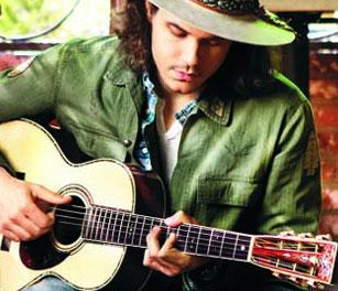 John Mayer playing a Martin parlor guitar